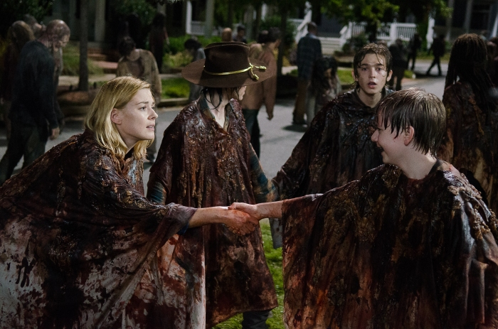 Chandler Riggs as Carl Grimes, Alexandra Breckenridge as Jessie Anderson, and Austin Abrams as Ron- The Walking Dead _ Season 6, Episode 9 - Photo Credit: Gene Page/AMC