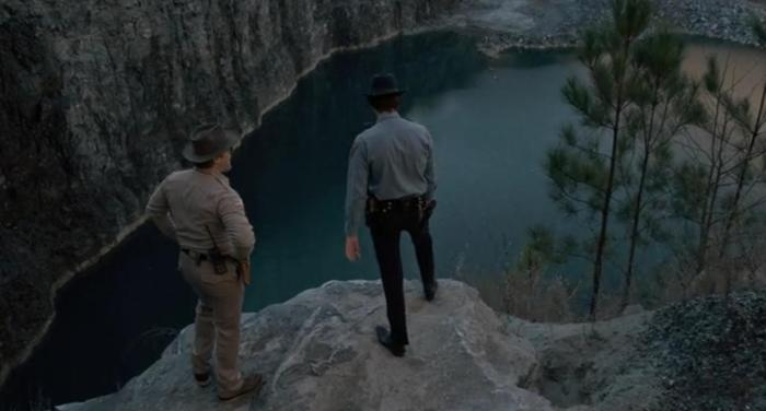 Netflix's Stranger Things Season 1 Episode 2 Hopper looking out over the quarry