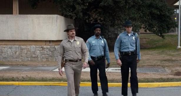 Netflix's Stranger Things Season 1 Epiosode 3 Holly Jolly Hopper in a hat