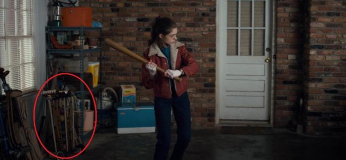 Netflix's Stranger Things Season 1 Episode 5 The Flea and the Acrobat Nancy with a bat croquet set circled