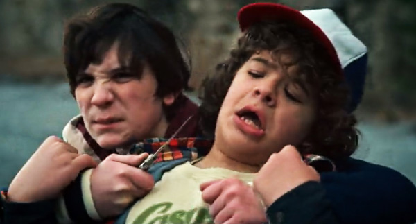 Netflix's Stranger Things Season 1 Episode 6 The Monster Pee-Pants Troy threatens Dustin with a knife at the quarry
