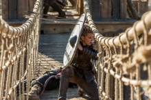 History's 'Vikings,' Season 4, Part 2, Episode 19, On The Eve, Lagertha with shield on a bridge