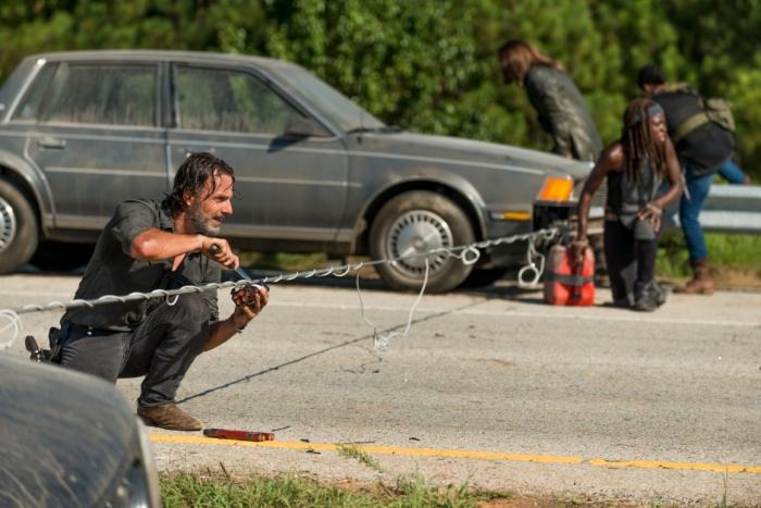 AMC's 'The Walking Dead,' Season 7, Episode 9, Rick Grimes retrieves dynamite from a roadblock