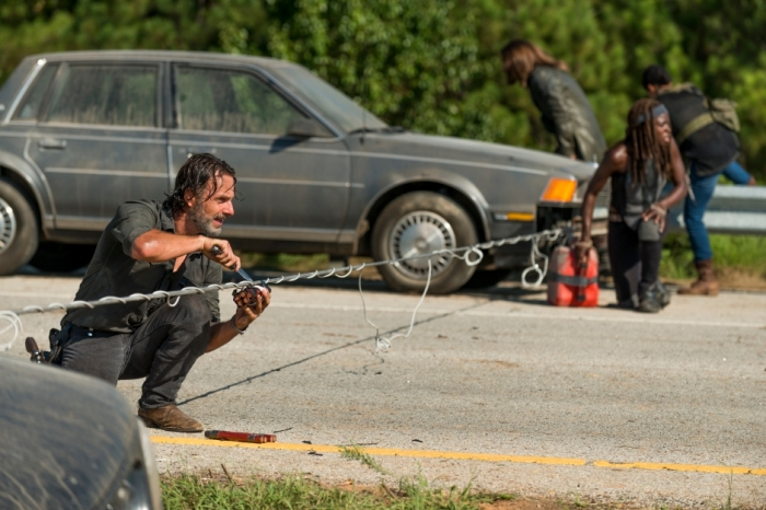 AMC's 'The Walking Dead,' Season 7, Episode 9, Rick Grimes retrieves dynamite from a roadblock